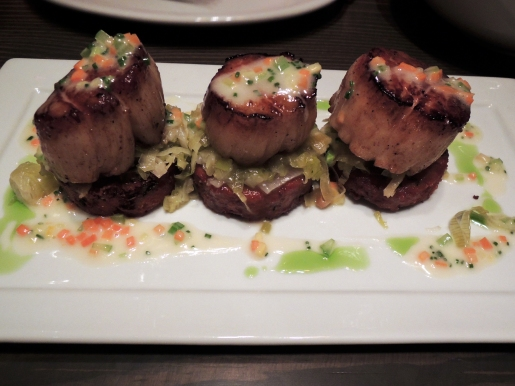 Diver scallops on top of zucchini cakes